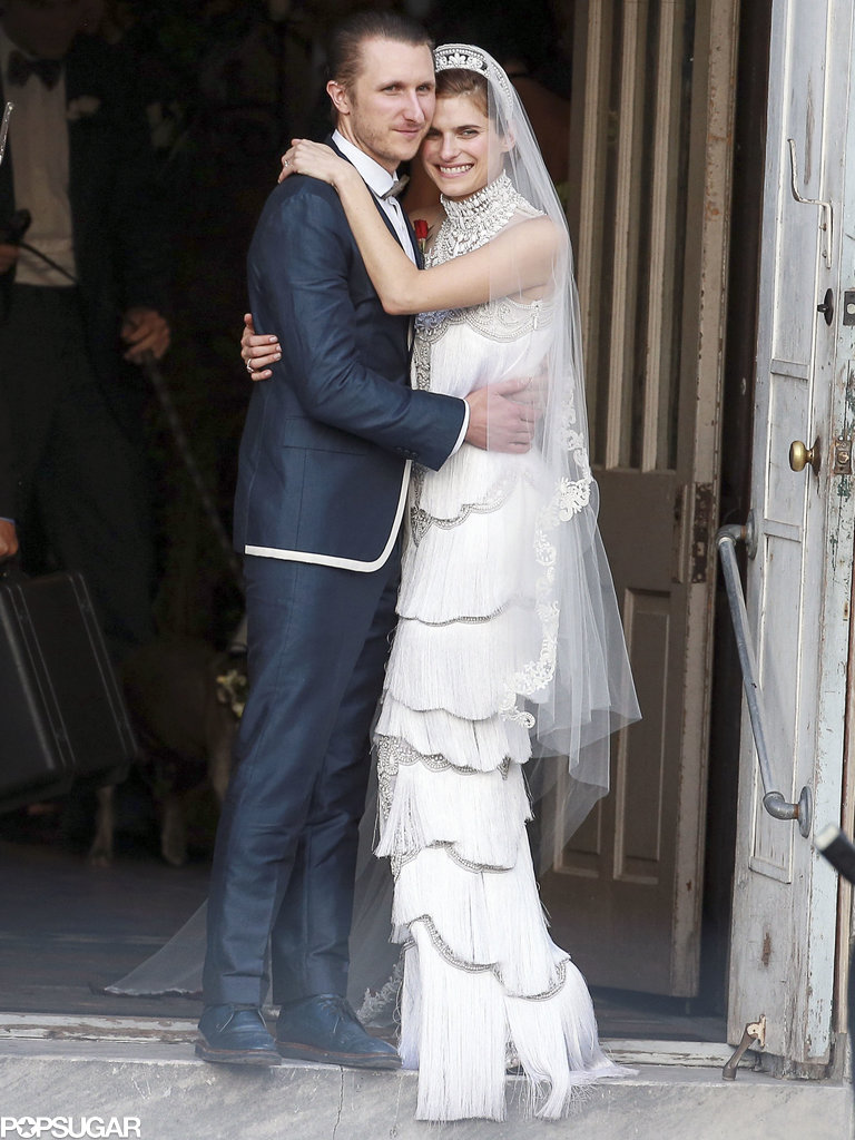 Lake Bell cuddled up to her new husband, Scott Campbell, after their June 2013 ceremony in New Orleans.