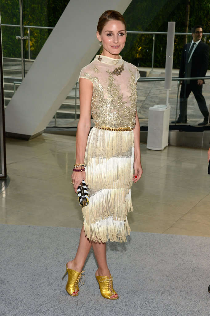 Olivia Palermo channeled the chicest '20s flapper in a gold fringe Dennis Basso number and matching gold lace-up peep-toe booties.