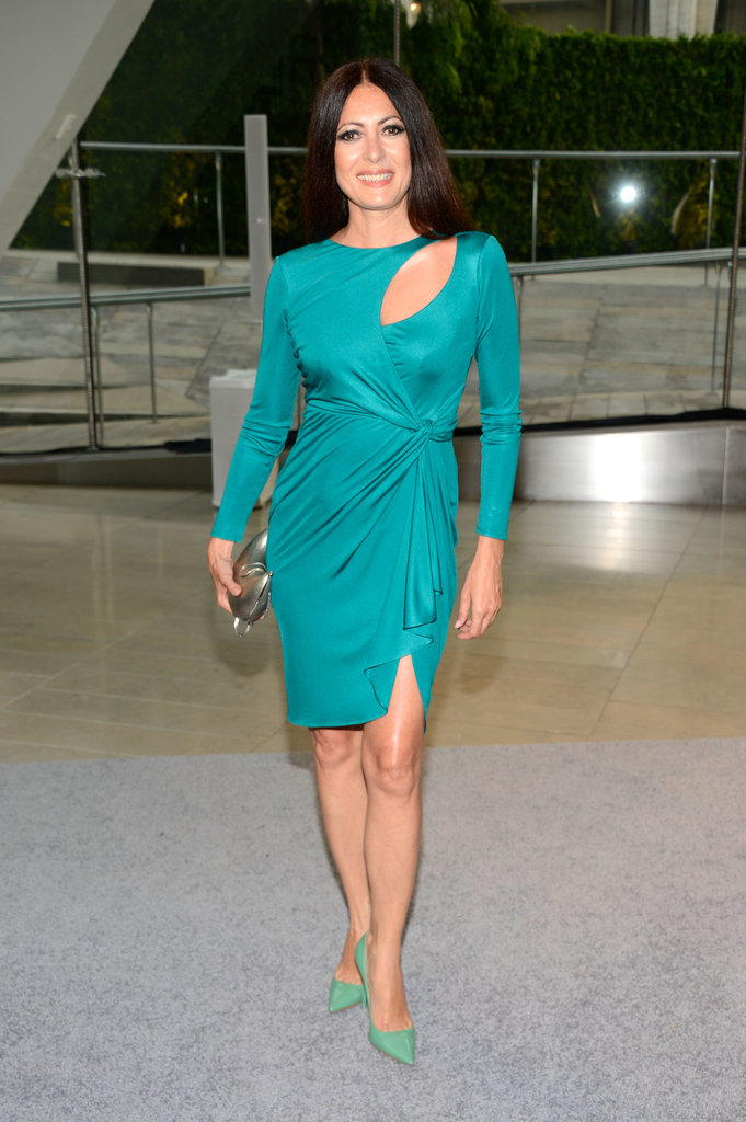 Catherine Malandrino stood out in her turquoise cutout dress and green pumps.