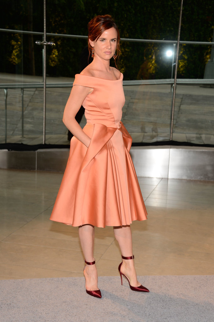 Juliette Lewis was dainty as ever in an orange satin Zac Posen fit-and-flare dress.