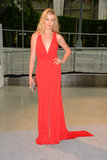 Ireland Baldwin went for a classic red plunging David Meister gown, then added shine via a metallic clutch.