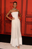 Joan Smalls was ethereal in a strapless white Givenchy by Riccardo Tisci Resort 2014 gown, which she amped up with a shiny collar necklace.