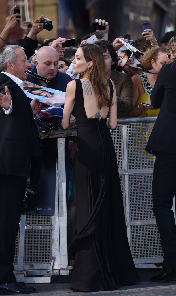 The revealing back showed off Angelina's famous ink.