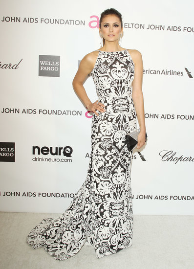 Nina took the black-and-white trend to new heights working a bold printed Naeem Khan gown with sexy open-back detail for Elton John's Academy Awards viewing party in January 2013.