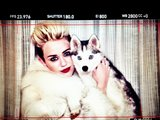 Miley Cyrus posted a photo of herself with one of her dogs on the set of her music video. Source: Twitter user mileycyrus