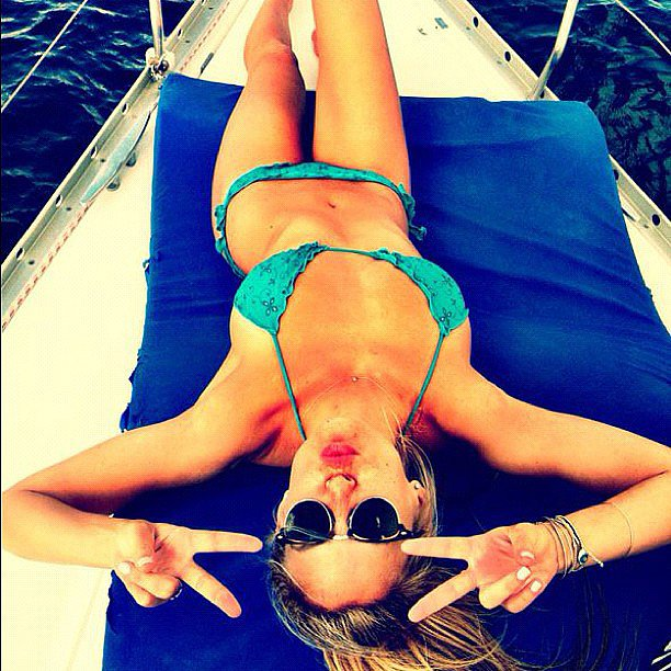 Bar Refaeli flashed peace signs while lounging on a boat in October 2012. Source: Instagram user barrefaeli