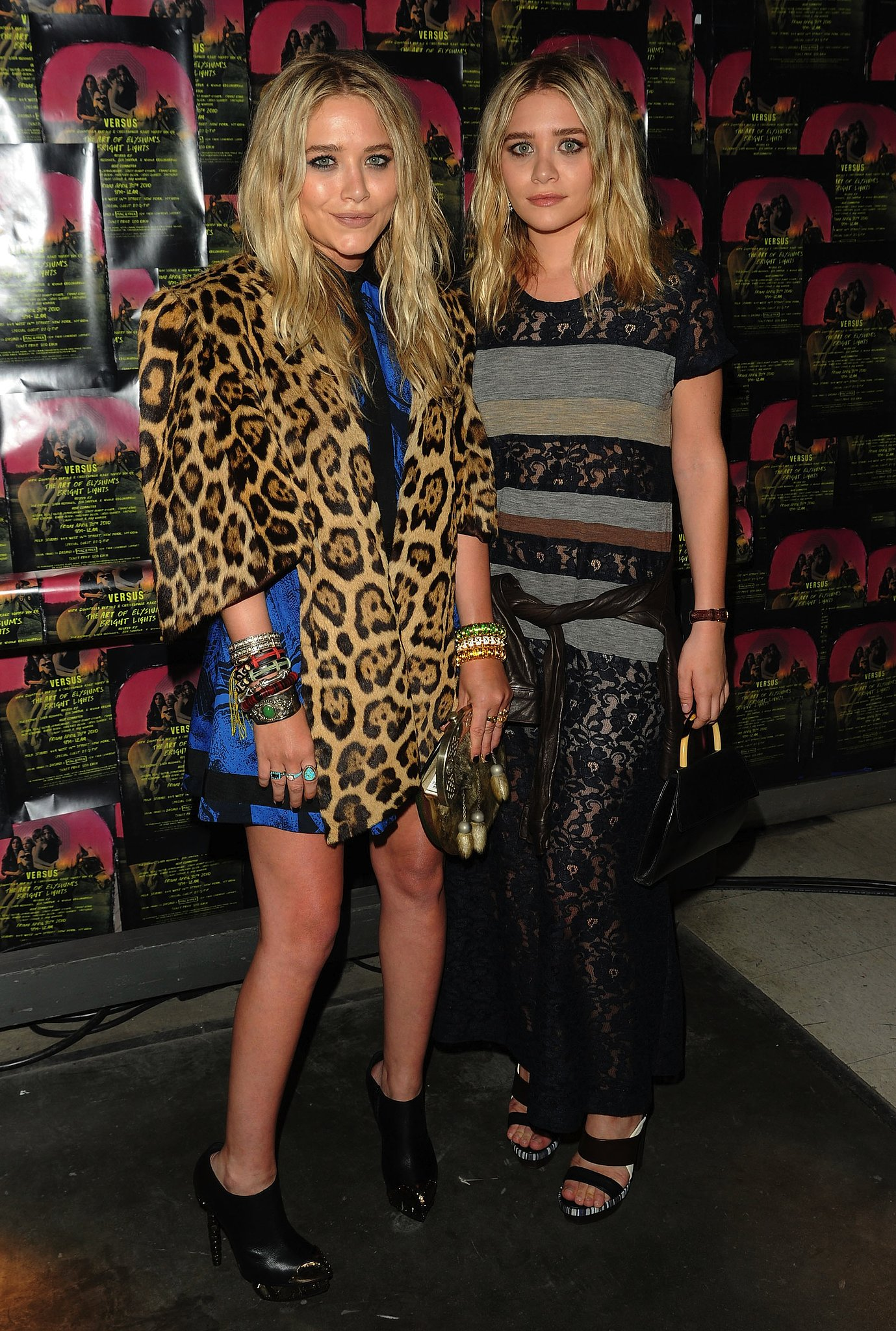 """Twinning combo: In May 2010, MK&A married prints and patterns at The Art of Elysium and Versus's """"Bright Lights"""" fundraiser in NYC.  Mary-Kate topped her brilliant blue printed mini with a leopard cape and serious stacks of arm candy. Ashley cinched her paneled lace Comme des Garcons dress with a chocolate-brown leather jacket."""
