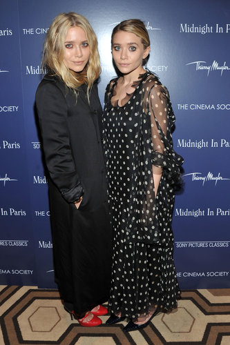Twinning combo: The Olsens hit the NYC screening of Midnight in Paris oozing Parisian-chic sophistication.  Mary-Kate warmed up in a long black silk coat and fiery red rounded pumps. Ashley looked whimsical in a sheer polka-dot dress and black crocodile pumps.