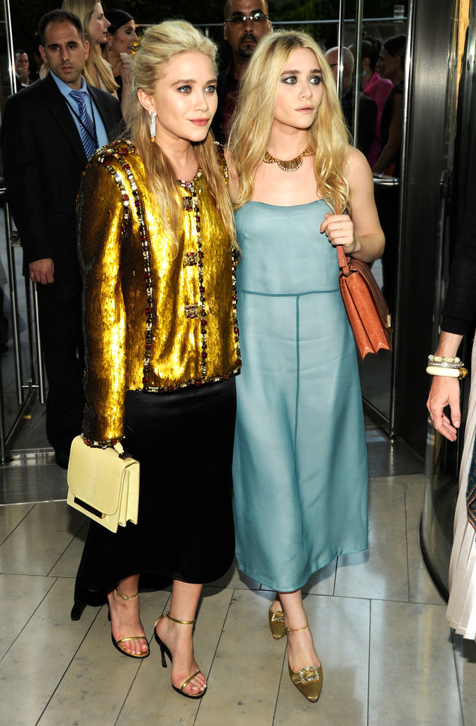 Twinning combo: For the 2011 CFDA Fashion Awards, both girls kicked it into high-gear with high-shine pieces.  Mary-Kate donned an embellished gold Chanel topper, black high-low skirt, and pastel bag by The Row.  Ashley went a little more subtle in a sheen, baby-blue creation and burnt-orange crocodile bag, both by The Row, with metallic ankle-strap pumps.