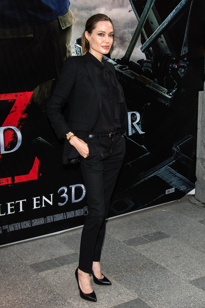 Angelina was polished and cool in Saint Laurent suiting, which she finished with a gold bangle and black pumps.