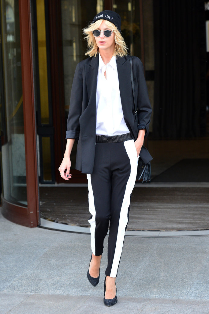 Anja Rubik made the streets of Warsaw stylish with her tuxedo-inspired ensemble topped with a beanie and round sunglasses.