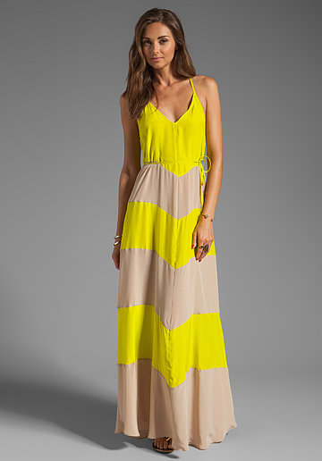 We appreciate the juxtaposition between the bright yellow and nude in this Karina Grimaldi striped maxi dress ($306).