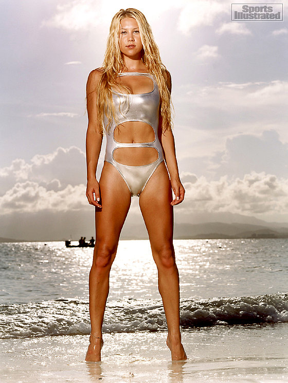 Anna Kournikova sizzled in a metallic swimsuit for the Sports Illustrated swimsuit edition in 2004. Source:Tiziano Magni/Sports Illustrated