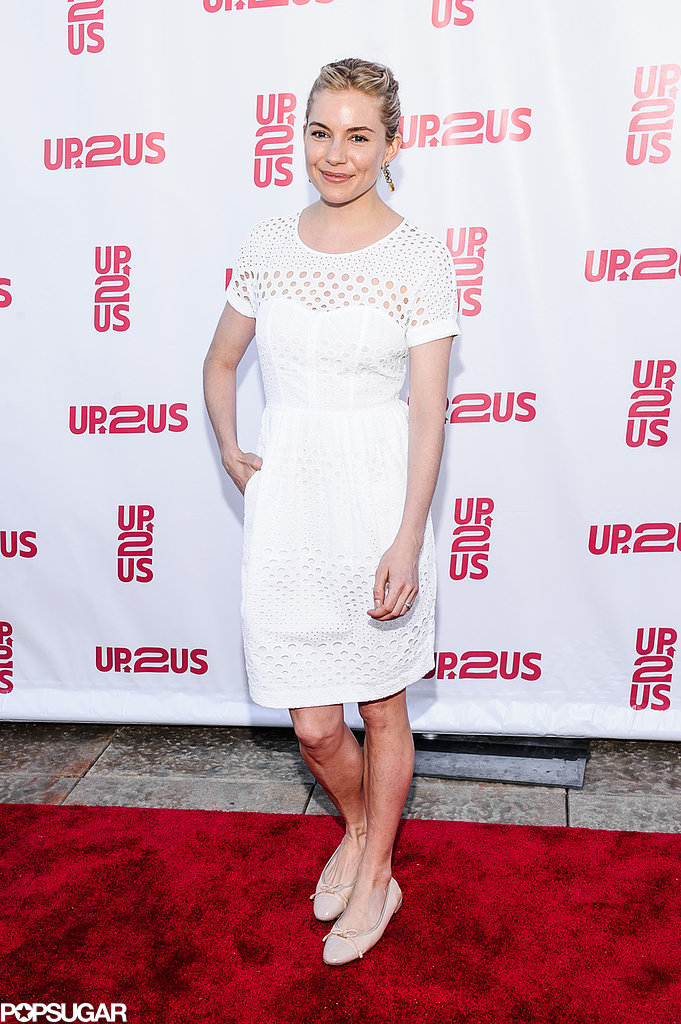 Sienna Miller wore a white frock.