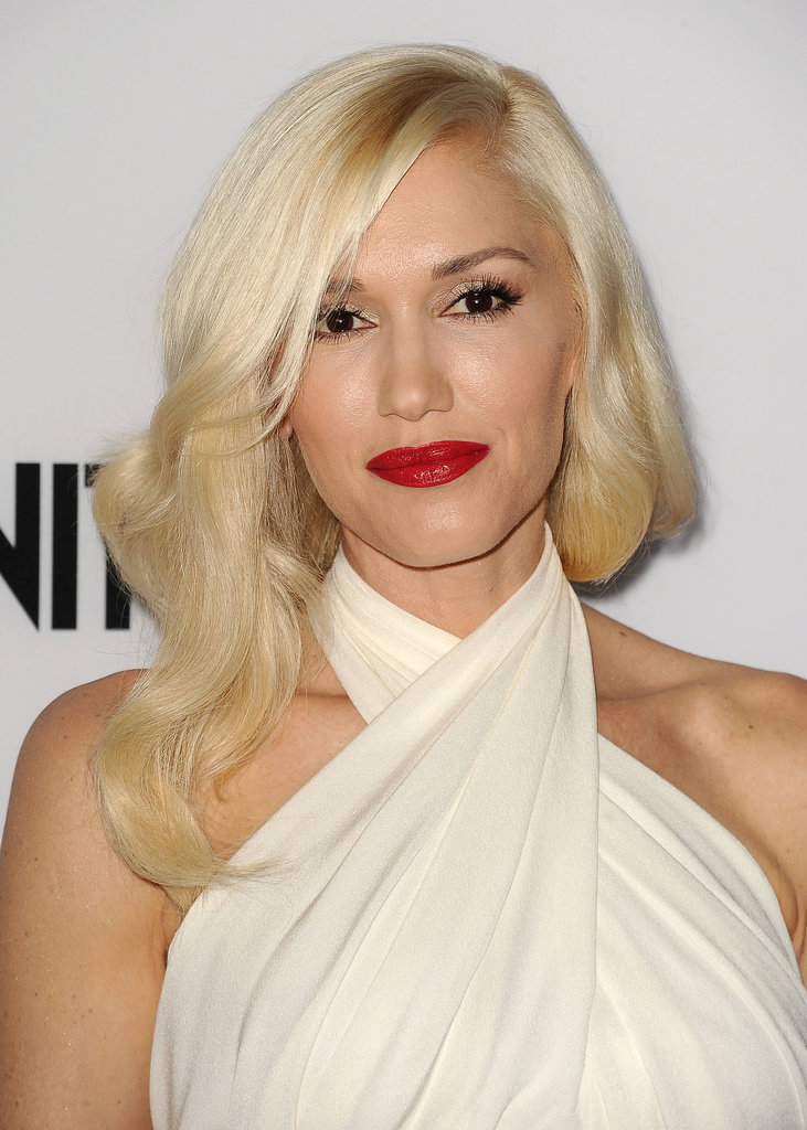 Wearing her signature red lipstick, Gwen Stefani glammed up her look with exaggerated lashes and flowing platinum waves for the The Bling Ring's carpet.