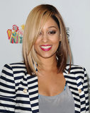 Tia Mowry's two-toned hair colour adds excitement to her medium-length cut with a jet-black hue underneath and honey blonde around the top layers.