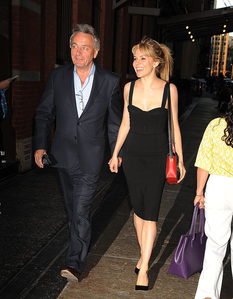 Sienna Miller walked hand-in-hand with a man.