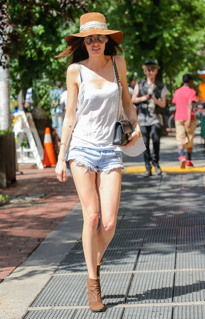 Nicole Trunfio embraced the Summer sun in her denim cutoffs, a lacy white camisole, finished with a wide-brim hat, aviator sunglasses, and brown booties.