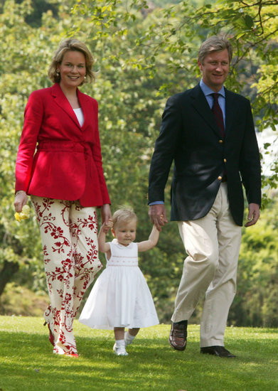 Belgium's Princess Elisabeth walked with the help of her parents, Princess Mathilde and Prince Philippe, in 2003.
