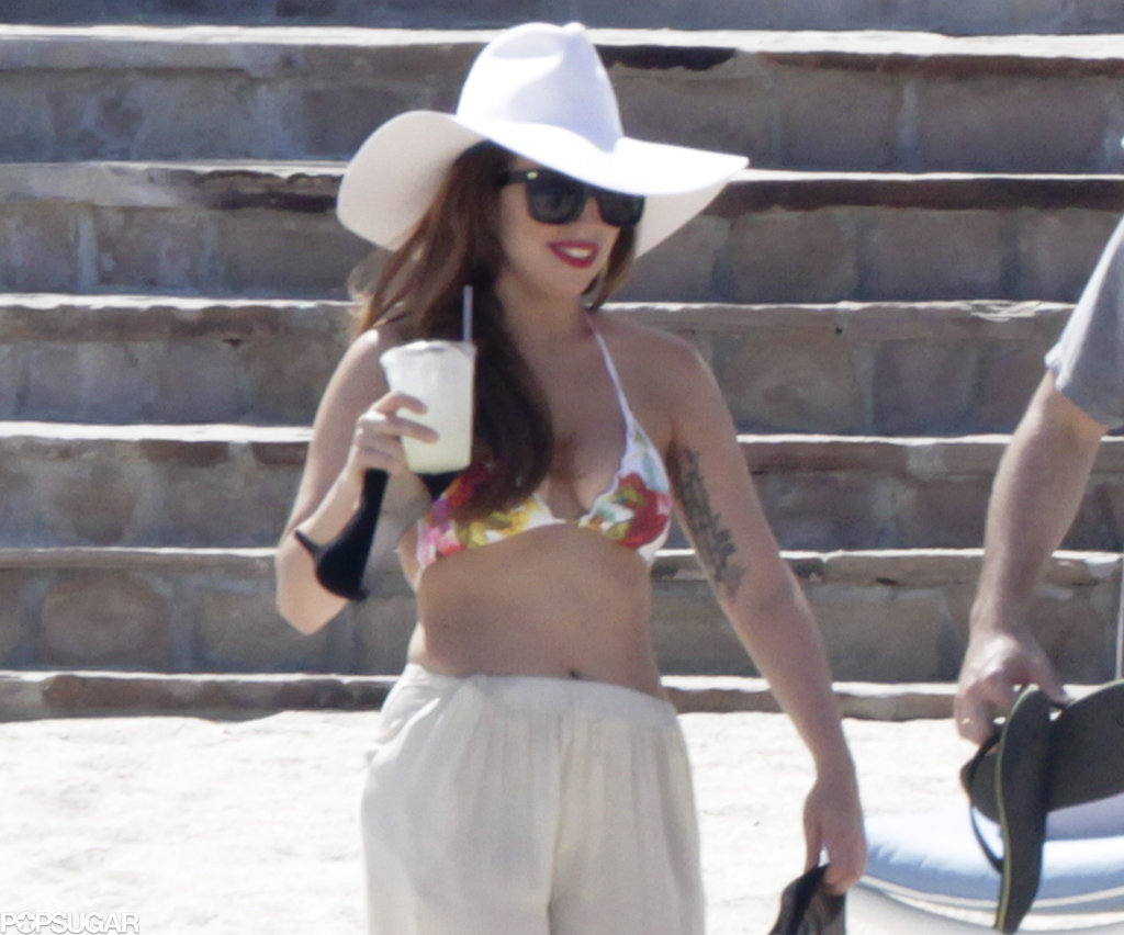 Lady Gaga wore a printed bikini top and a sun hat.