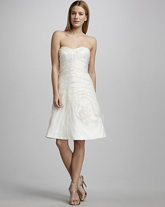 The fit-and-flare silhouette on this Carmen Marc Valvo organza rose cocktail dress ($1,980) gives it that extra-special touch.