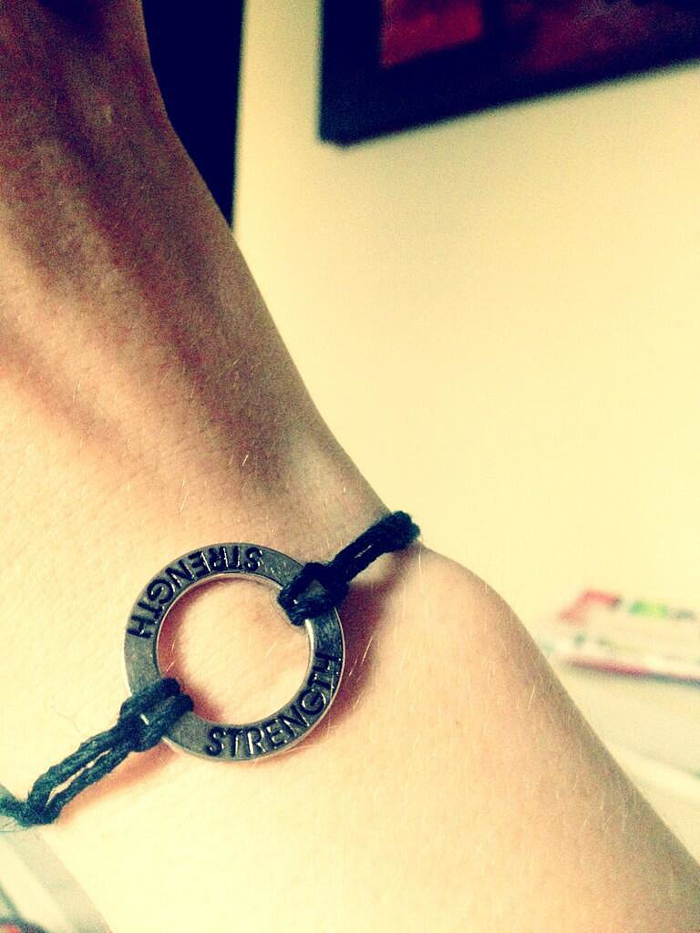 Amy C. Newbold wore her Divergent pride on her wrist. Source: Twitter user newbieames