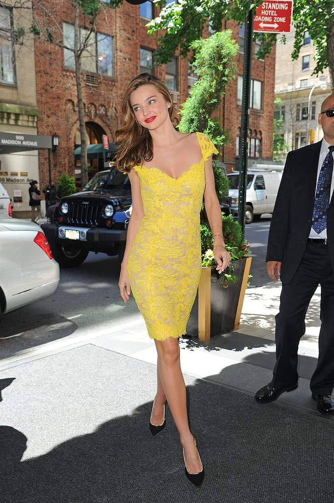 Miranda Kerr quite literally brought the sunshine in this bright Reem Acra sheath while out in NYC.