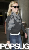 Reese Witherspoon smiled at LAX on Monday.