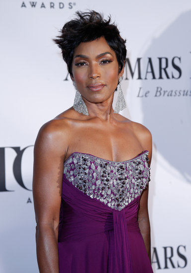Angela Bassett's metallic eye makeup and glowing skin paired beautifully with her aubergine gown.