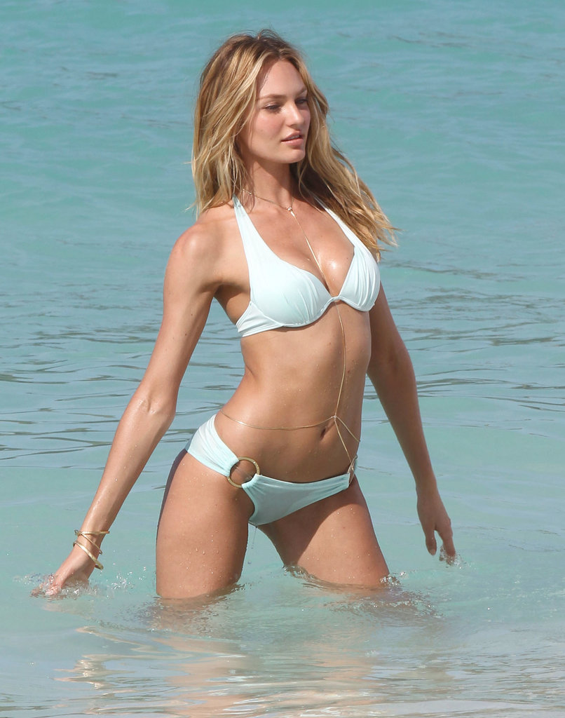 Candice Swanepoel sported windblown waves as she shot a bathing-suit campaign in beautiful blue waters.