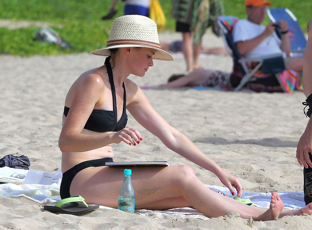 Alexis Bledel protected her fair skin and dark hair while on vacation with a stylish wide-brimmed hat.