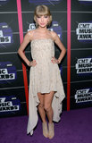At the 2013 CMT Awards, Taylor Swift ditched strappy sandals for lace peep-toe booties and a nude strapless high-low dress by Elie Saab.
