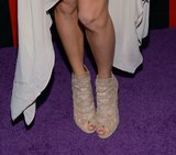 Taylor's booties edged up her dainty dress.