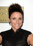 Julia Louis-Dreyfus's topknot and icy blue shadow made for a cool combination.