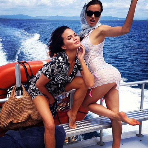 Things got sexy on a boat for Chrissy Teigen and Irina Shayk during a bikini photo shoot. Source: Instagram user chrissyteigen