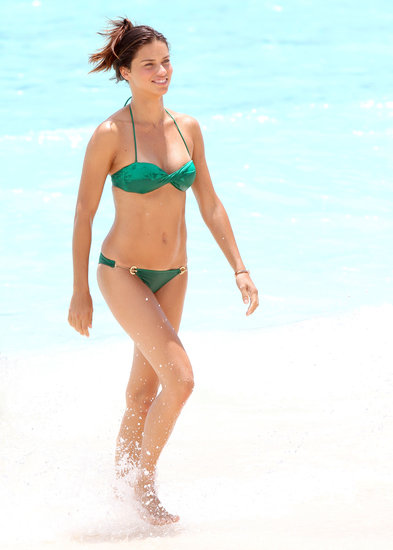 In May, Adriana Lima wore a green bikini for a dip in St. Barts.