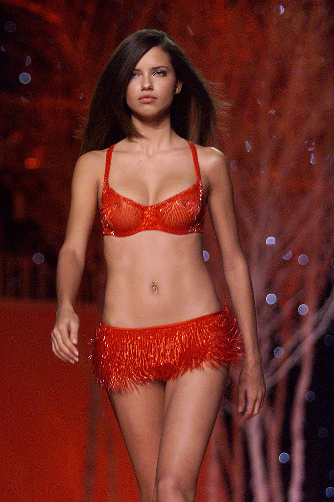 Adriana Lima sizzled in feathery red lingerie for the Victoria's Secret Fashion Show in Miami in November 2001.