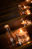 Glass lab tools set a romantic scene as votive holders.  Source: Mariana Mosli, Kismisink Photography