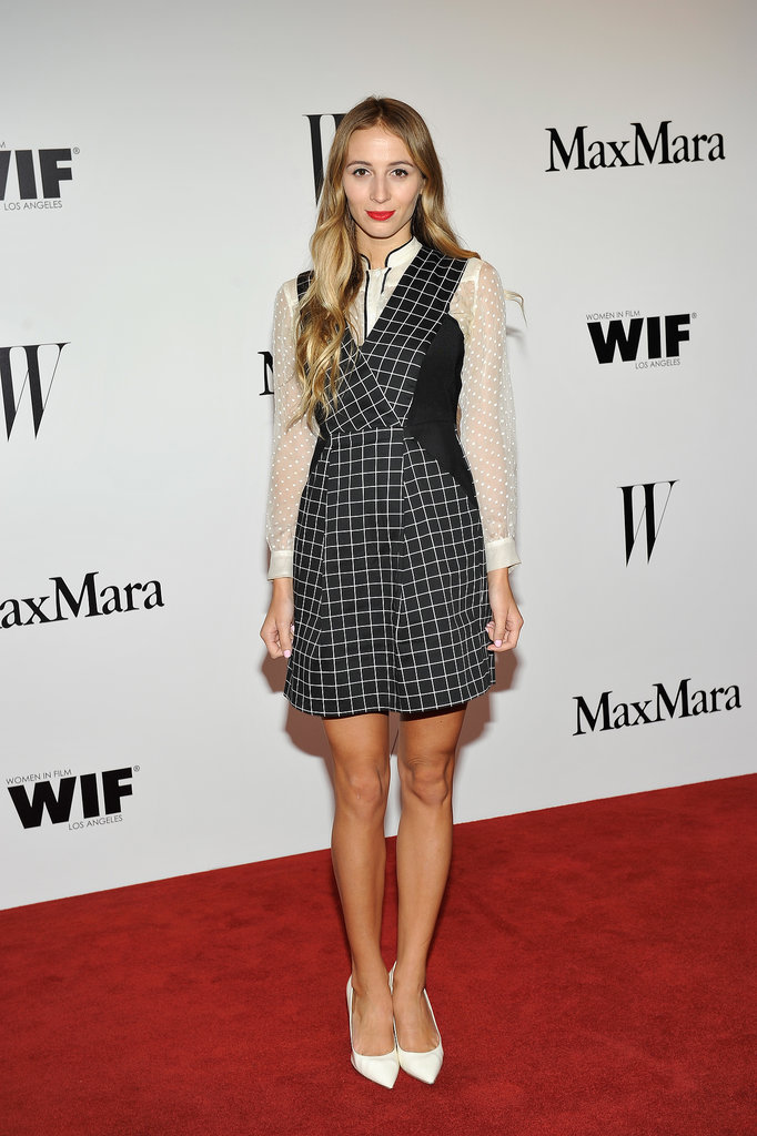 Harley Viera-Newton was both polished and playful in a Sportmax black-and-white, silk cotton, checkered V-neck dress and silky white button-down layered underneath. Posh white pumps finished it off.