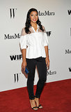 Playing it cool in white and black, Hannah Bronfman arrived in a Max Mara cotton illusion top and black neoprene skinnies, which she offset with a pop of color on her clutch.