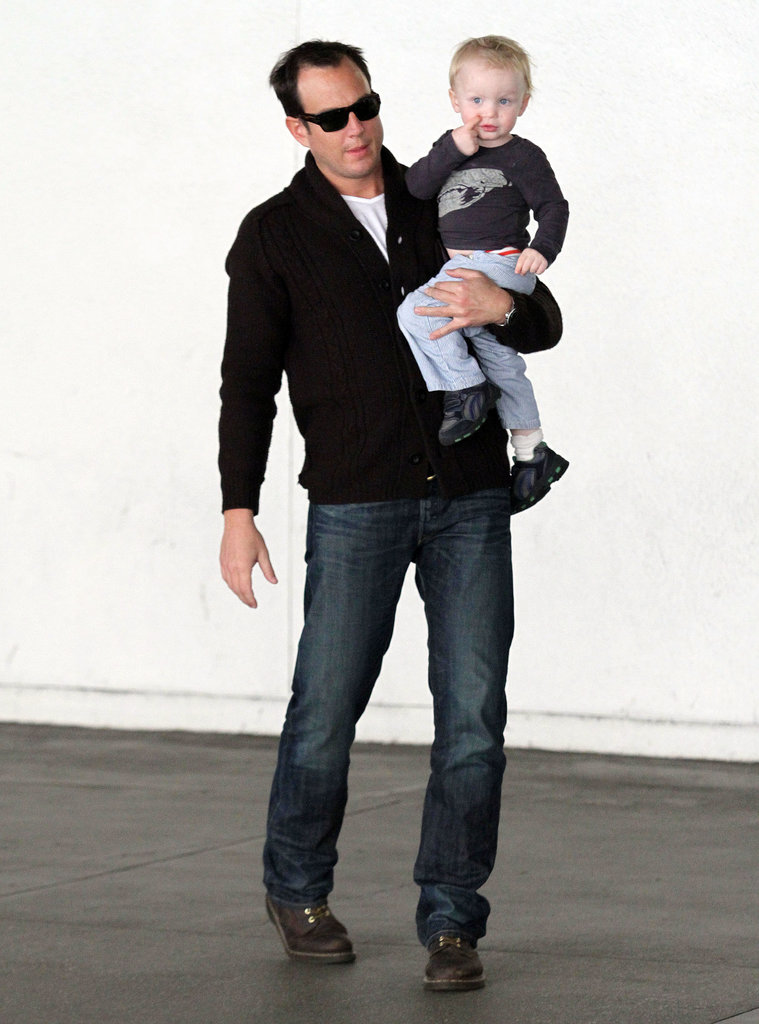 Will Arnett carried his son after arriving in LAX on January 2011.