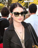 Michelle Trachtenberg's low ponytail is given a little personality with a casual middle part.