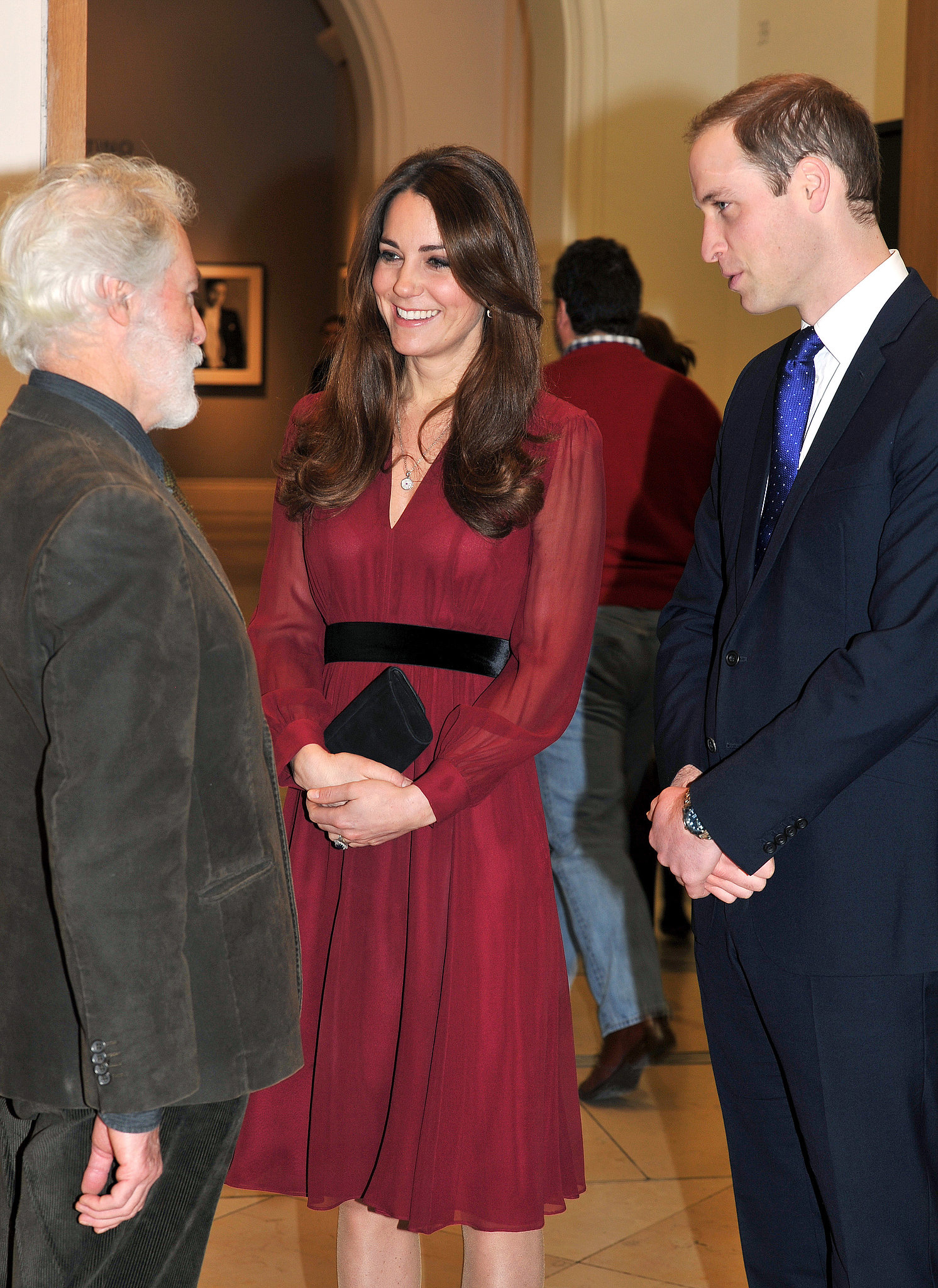 Kate smiled with artist Paul Emsley and Prince William when she attended an unveiling of her official portrait at the National Portrait Gallery in January 2013.