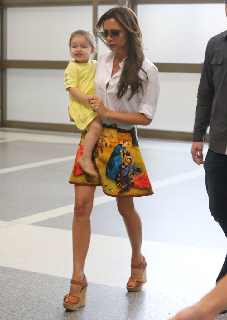 We wouldn't expect anything less chic from Victoria Beckham while traveling. She arrived in style wearing a crisp white button-down with a flirty printed skirt and tan wedge sandals. If you dare, do the same on your next getaway. Hey, at least you'll be ready to hit the town once you land.