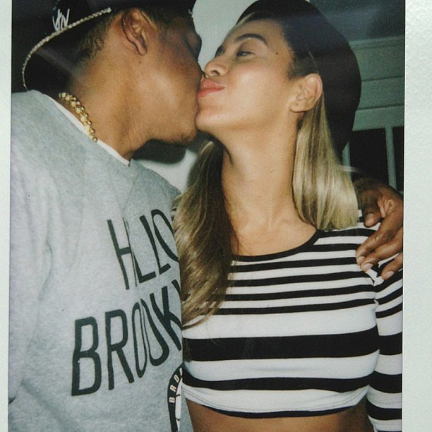 Beyoncé Knowles planted a sweet kiss on Jay-Z, and we're loving those stripes! So Frenchy, so chic. Source: Instagram user beyonce