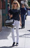 Karolina Kurkova matched light with dark in white skinny jeans and a gray tee in NYC. She finished with black boots and a black-and-white-striped Marc Jacobs bag.