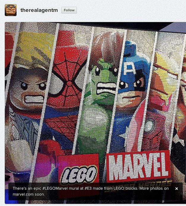 Executive editorial director of Marvel, Ryan Penagos, snaps a pic of the incredible LEGO Marvel mural at the E3 gaming expo.