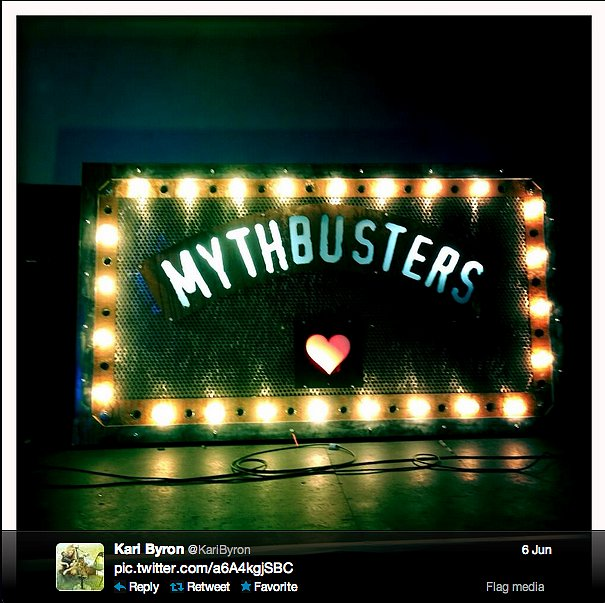 Kari Byron of MythBusters puts some lit-up love for the show on the display.