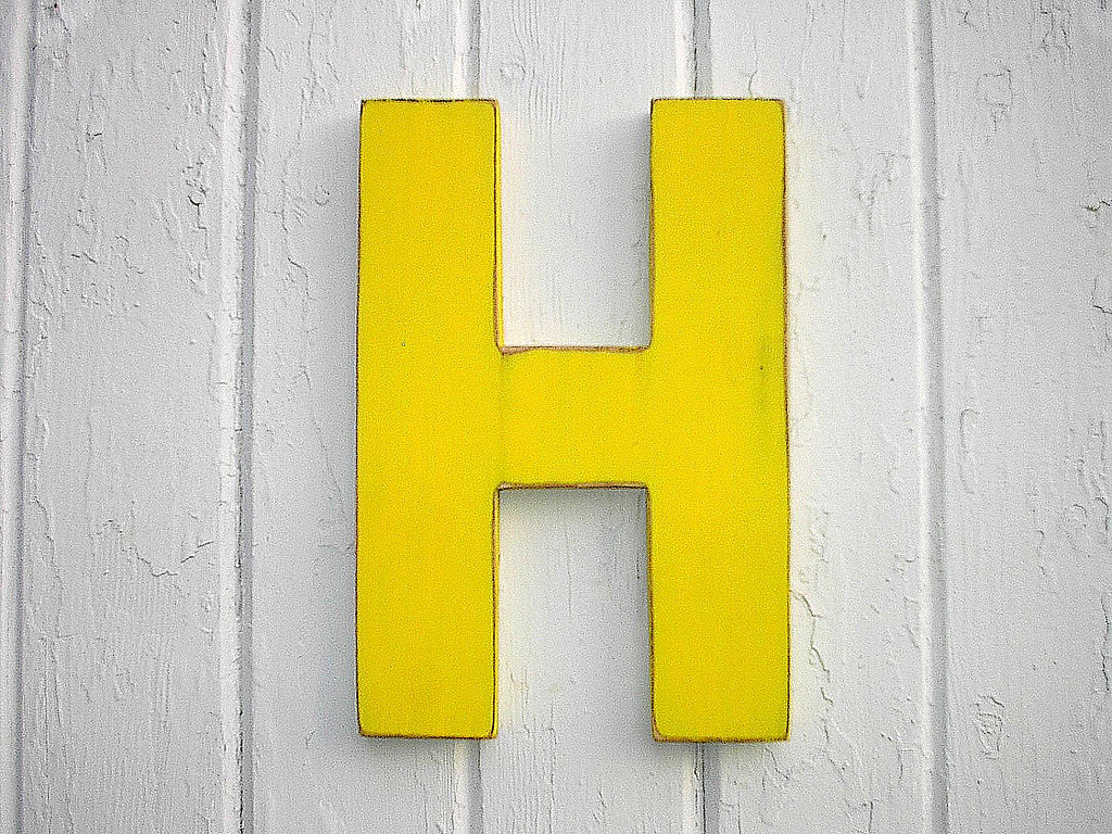 Add a vibrant pop of color to the wall with this rustic wooden letter ($25).
