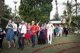 "Play Dress Up Whether it's costumes at a Halloween wedding or just hats and props for the reception, guests love an excuse to dress up. This wedding had a Beatles theme: ""Sgt. Pepper Pool Party."" Photo by Ashleigh Taylor Photography via Green Wedding Shoes"